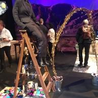 The headless man climbs a ladder